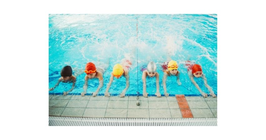 kids practice swimming, behind anchor,
