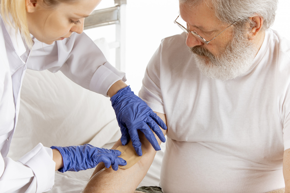 An image of a provider doing blood work with a patient.