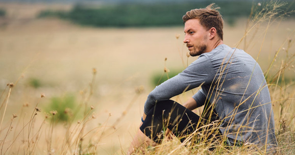 A guy sitting alone in nature https://www.elitedaily.com/dating/guy-never-been-in-relationship/1388437