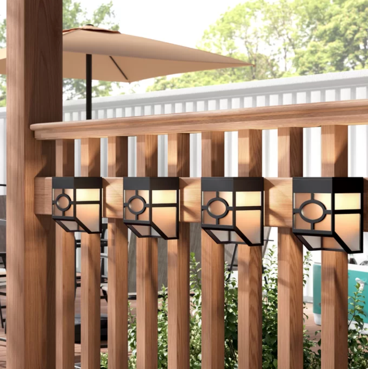 Wall lights used on a wooden fence in an outdoor space