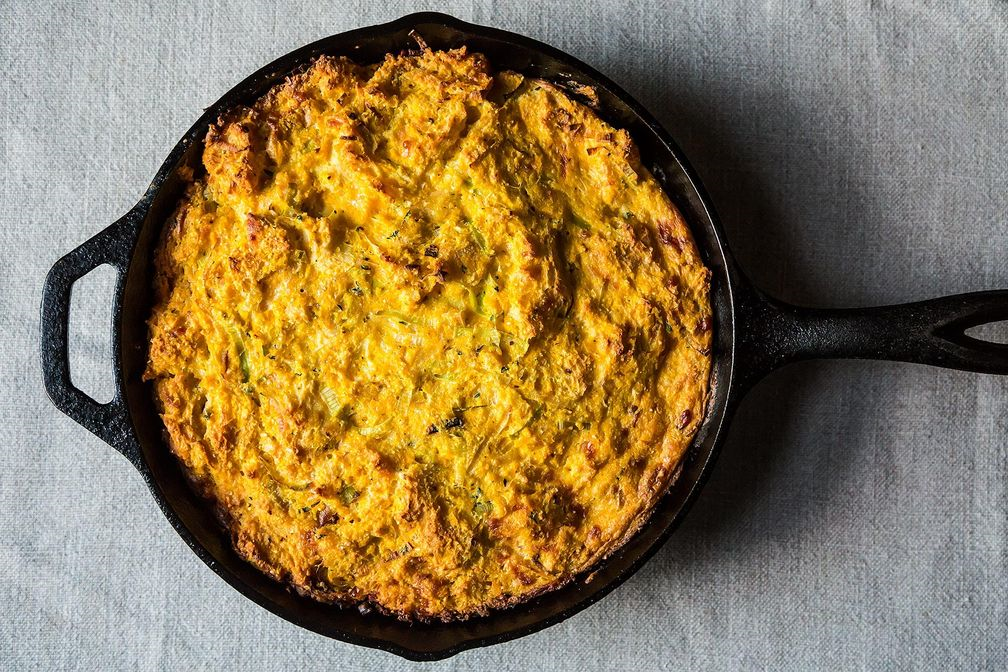 corn bread pudding in black skillet on tablecloth