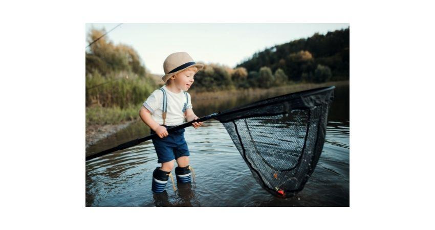 kids catching fish outdoors in  fishing spot