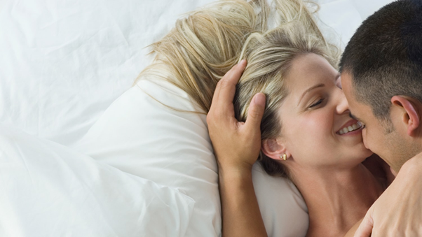 A couple getting intimate in bed https://www.today.com/health/7-ways-put-sexual-spark-back-your-relationship-t50326