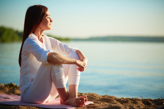 A woman meditating in nature https://medium.com/spiritual-secrets/4-major-signs-youre-having-a-spiritual-awakening-7f7caae59ad2