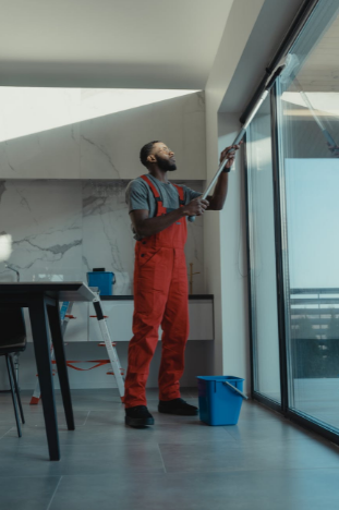 man in Dallas cleaning windows