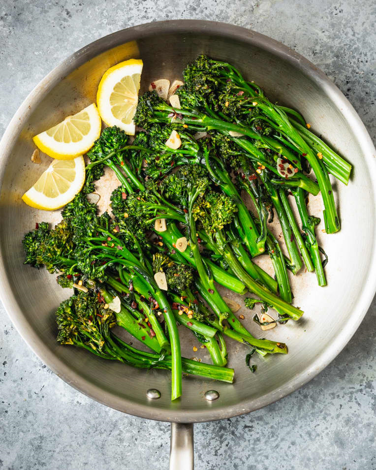 broccolini with garlic in pan with lemon