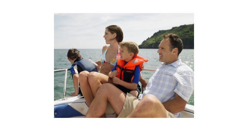 boating with kids, wearing life jacket aboard vessel