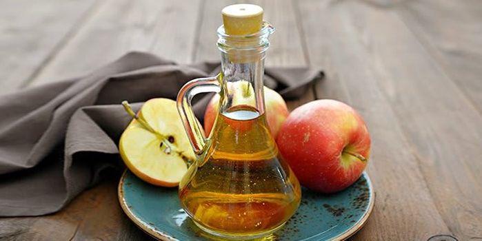 Apple cider vinegar works excellent for naturally lightening locks | TopTenHairCare.net